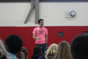 Speaking to the attending students, Freddie Silveria introduces a new group activity.