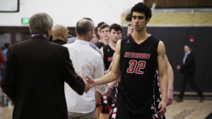 Shaking the opponents hands, Senior Omar Elliot-Diab walks off the court
