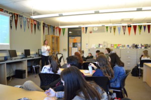 Redwood students meet in room 111 for a career conversation with environmental sustainability speaker.