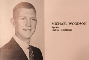 Smiling, Michael Woodson poses for his senior year yearbook photo in the 1959 Redwood Log.