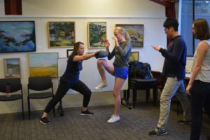 Practicing the knee-to-groin move with instructor Jemma Lester, senior Sarah Noble was part of a small group of teenagers present at the workshop.
