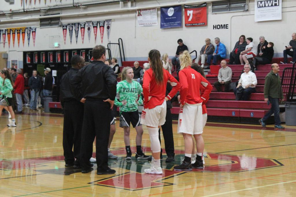 Co-captains Zoe Stachowski and Jenny Walker introduce themselves to opponent captains before the starting whistle.