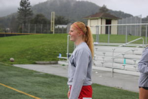 Bouton stands on the soccer field during practice.