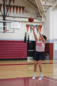 Practicing her shot during practice, Kylie wants to continue playing at the Divison I level like her mother Caren did.
