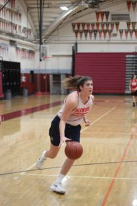 Playing on the court during practice, Kylie Horstmeyer is a starting shooting guard on the varsity basketball team.
