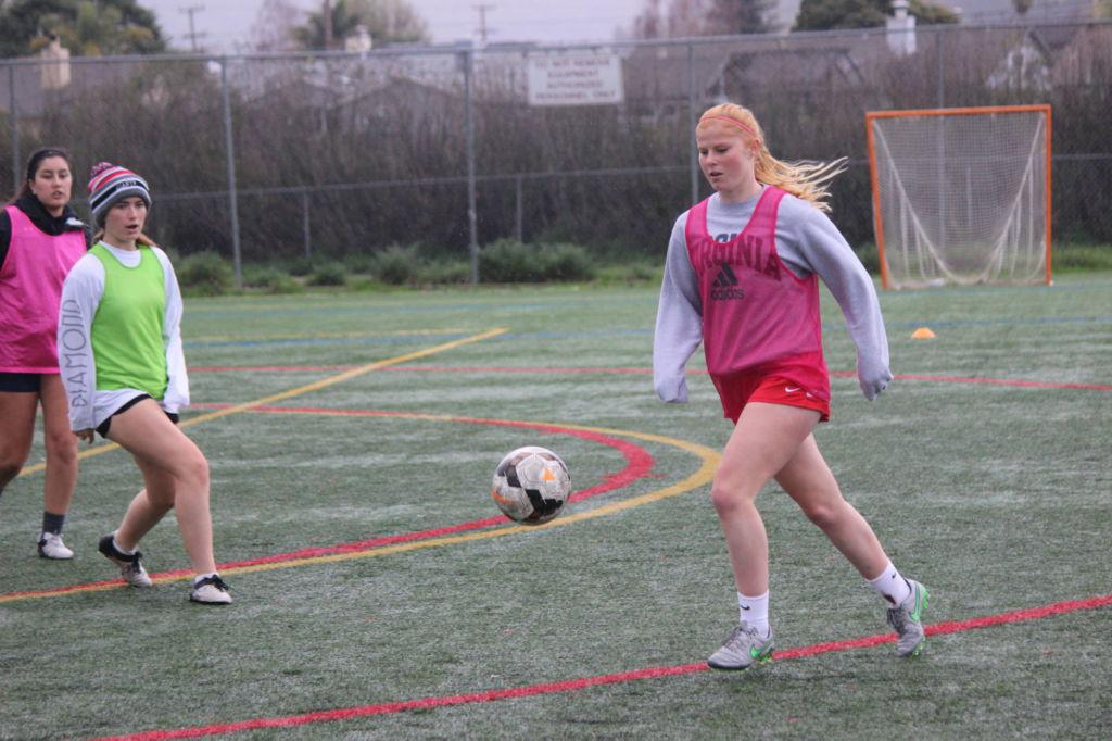Sophomore Grace Bouton battles on the soccer field