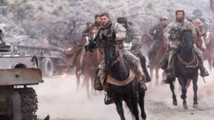 Soldiers riding on horseback while at war with the Taliban.