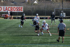 Junior Nick Piedimonte aggressively attempts to get the ball from the opposing team.