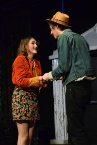 Hermia (Olivia Ray) discusses their plan to run away with Lysander (Ryan Bell)