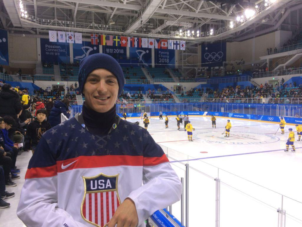 Traveling to Pyeongchang, junior Nathaniel Kuffner stands beside the Olympic hockey rink during a match at the 2018 Winter Olympics