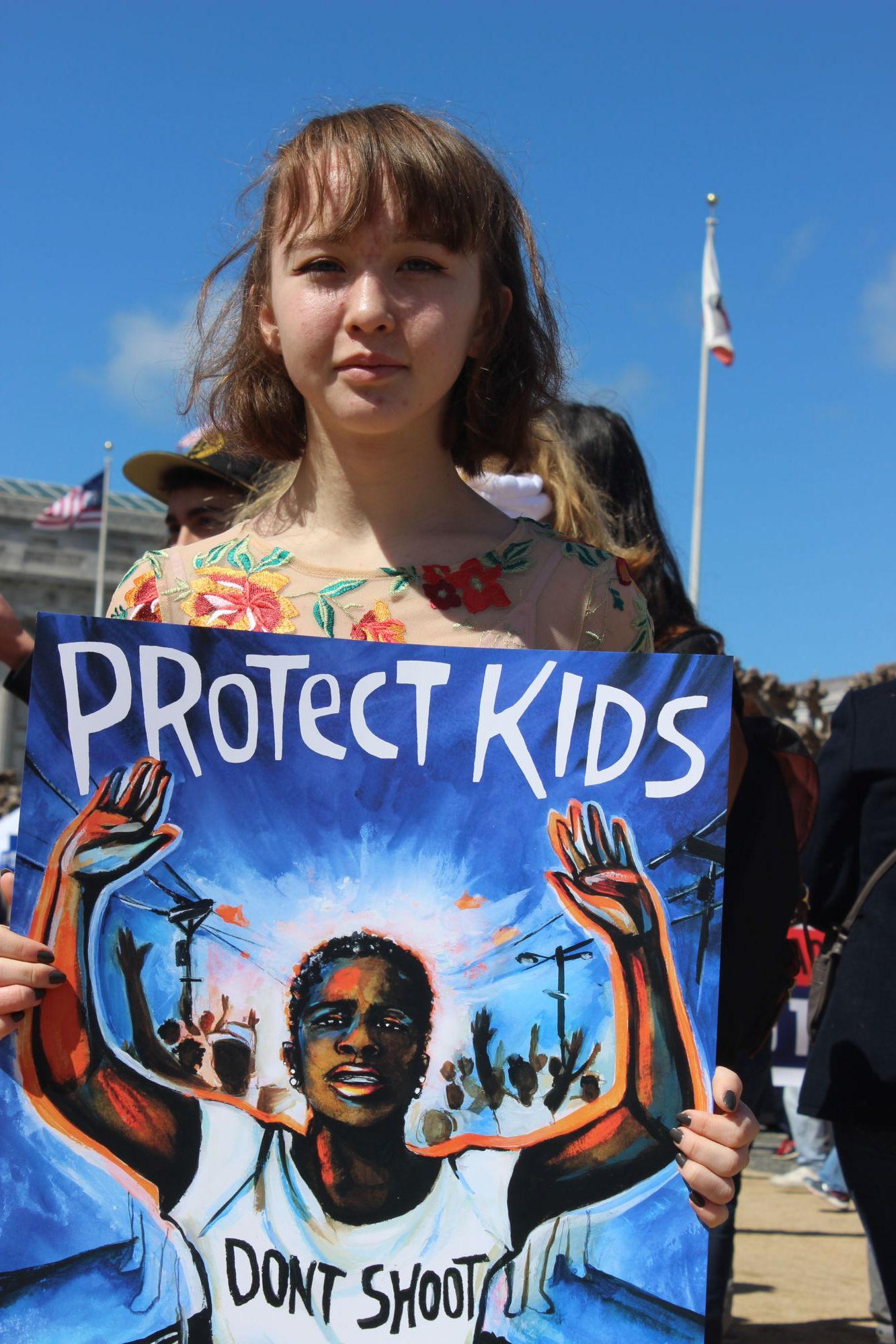 Sophomore+Layla+Isherwood+holding+sign+in+support+of+ending+gun+violence+