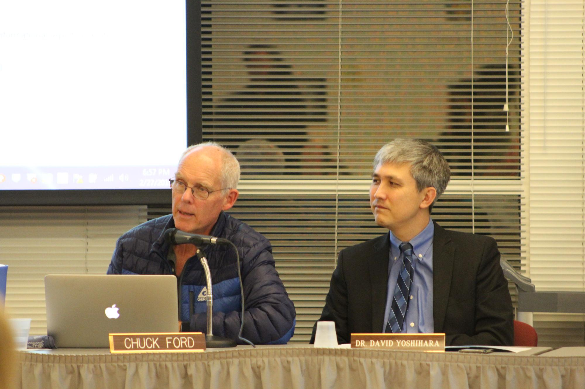 Superintendent+David+Yoshihara+and+Board+member+Chuck+Ford+listen+intently+at+the+last+board+meeting.