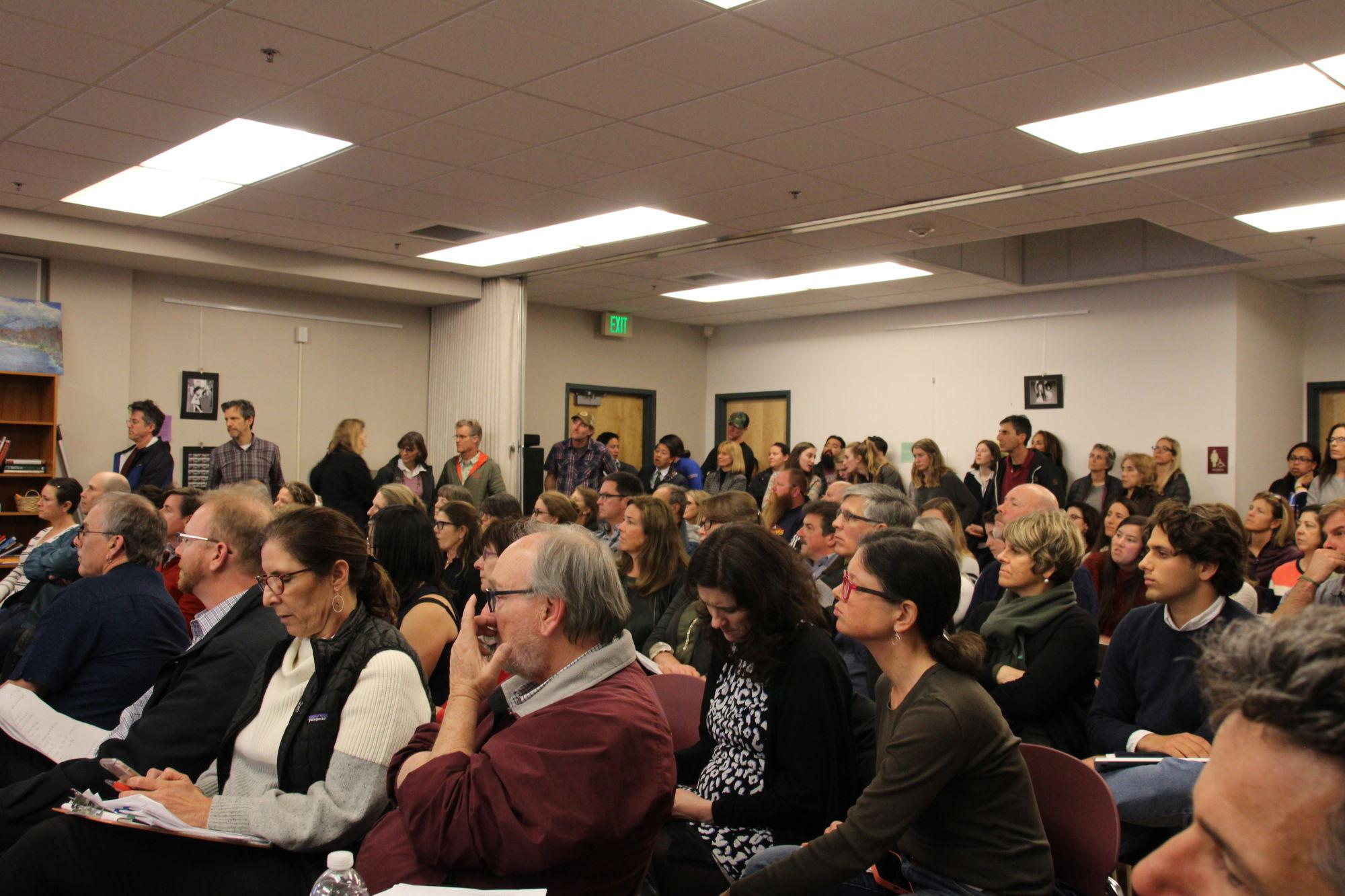 Community+members+lined+the+walls+of+the+last+board+meeting+to+address+their+concerns+regarding+program+cuts.+