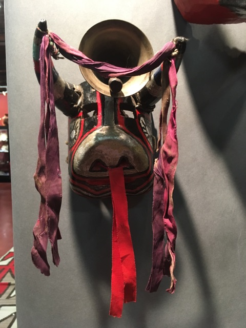From Kim Martindale's collection of Guatemalan masks, this mask's bull face with the bell is indicative of Guatemala's Nahualá people. The details on native masks represented specific communities throughout the country. Each group used their original masks during communal gathering events.