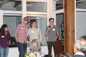 (Left to right) sophomores Scott McWhorter, Cole Panzardi and Matthew Millard speak about their work at MAYA at a donor event at Center for Domestic Peace's San Rafael office.