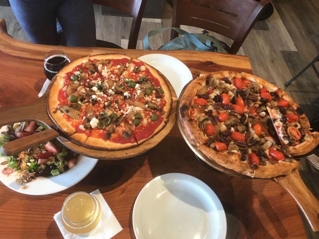 Two make your own pizzas (left with gluten free crust), Sweet Heart salad, and locally brewed root beer and kombucha.