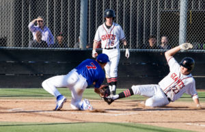 Ryan Jessen slides into home plate to extend lead