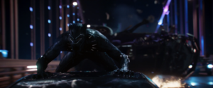The Black Panther pursues Ulysses Klaue from the top of a car