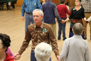 Club President Tom Shores joins in on a group dance