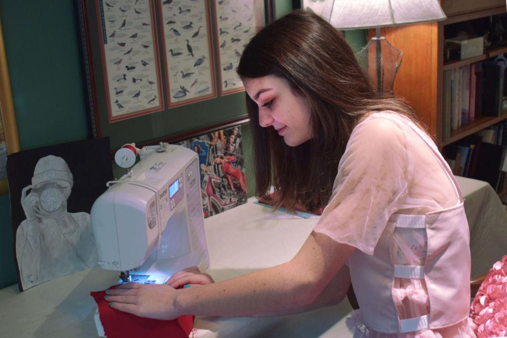 Annika Geissberger sewing her latest work in progress, the red ballgown.
