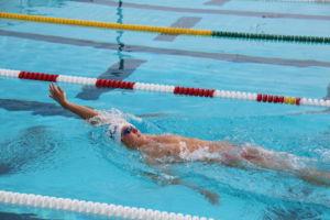 Kurakin glides through the pool in backstroke