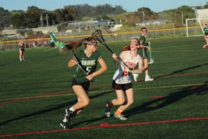 Freshman Samantha Glickman tries to prevent a Drake goal early in the second half