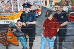Illuminating the injustice of stereotypes, this mural portrays the pain of two innocent teenagers who are wrongly convicted of a crime as a result of racial profiling.