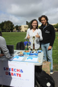 Isabella Liu (left) promotes the Speech & Debate club during Club Day as a senior.