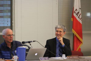 District Superintendent David Yoshihara discusses a resolution with fellow board members at a February board meeting.