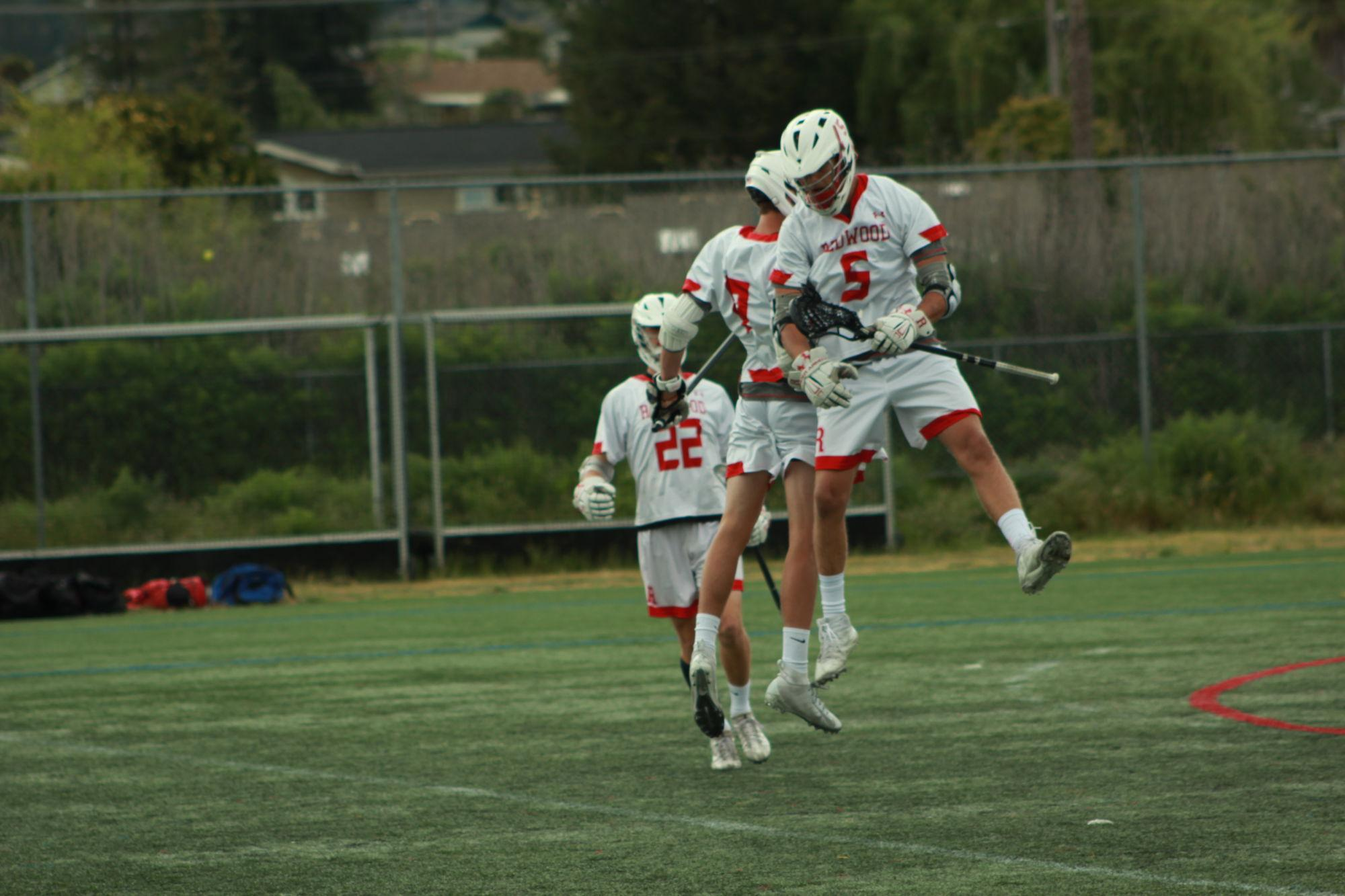 Junior+Harri+Hetrick+celebrates+with+his+teammate+after+Redwood+scores+a+goal.
