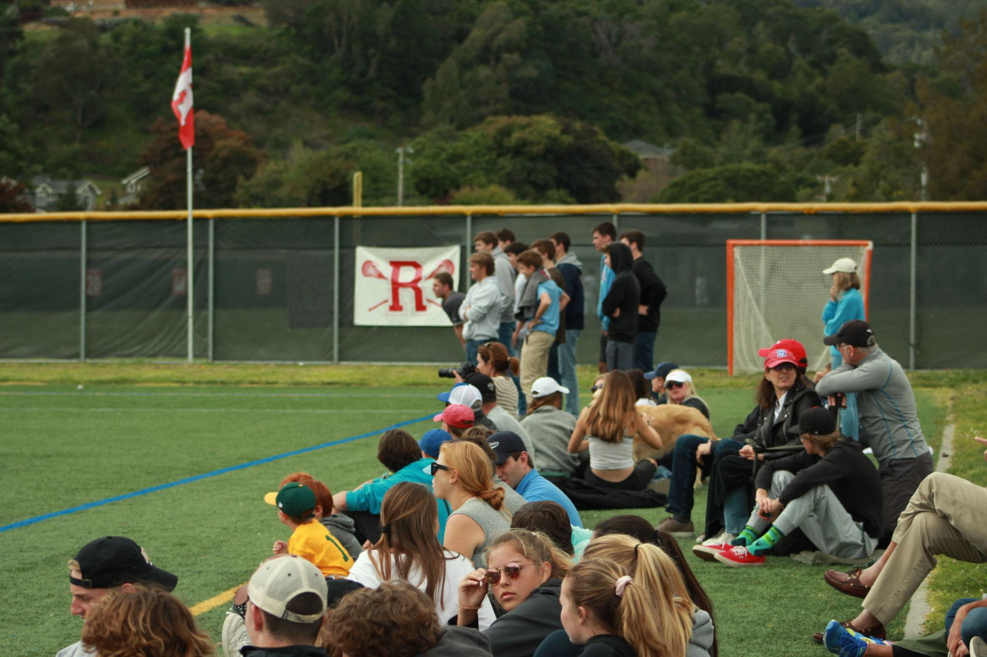The+crowd+of+students+at+the+highly+attended+game+watches+from+the+sideline.