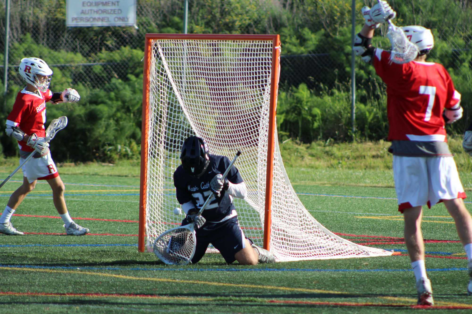 Marin+Catholic%27s+goalie+looks+down+as+the+ball+goes+past+him%2C+gaining+a+point+for+Redwood.