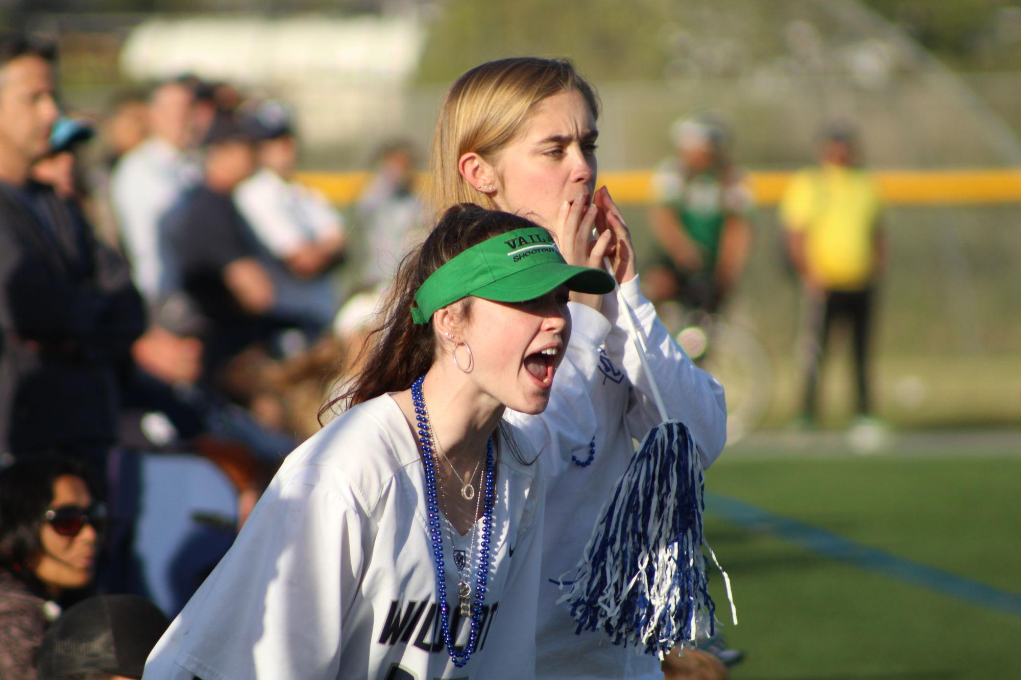 Two+students+from+Marin+Catholic+yell+at+the+players+from+the+sidelines.