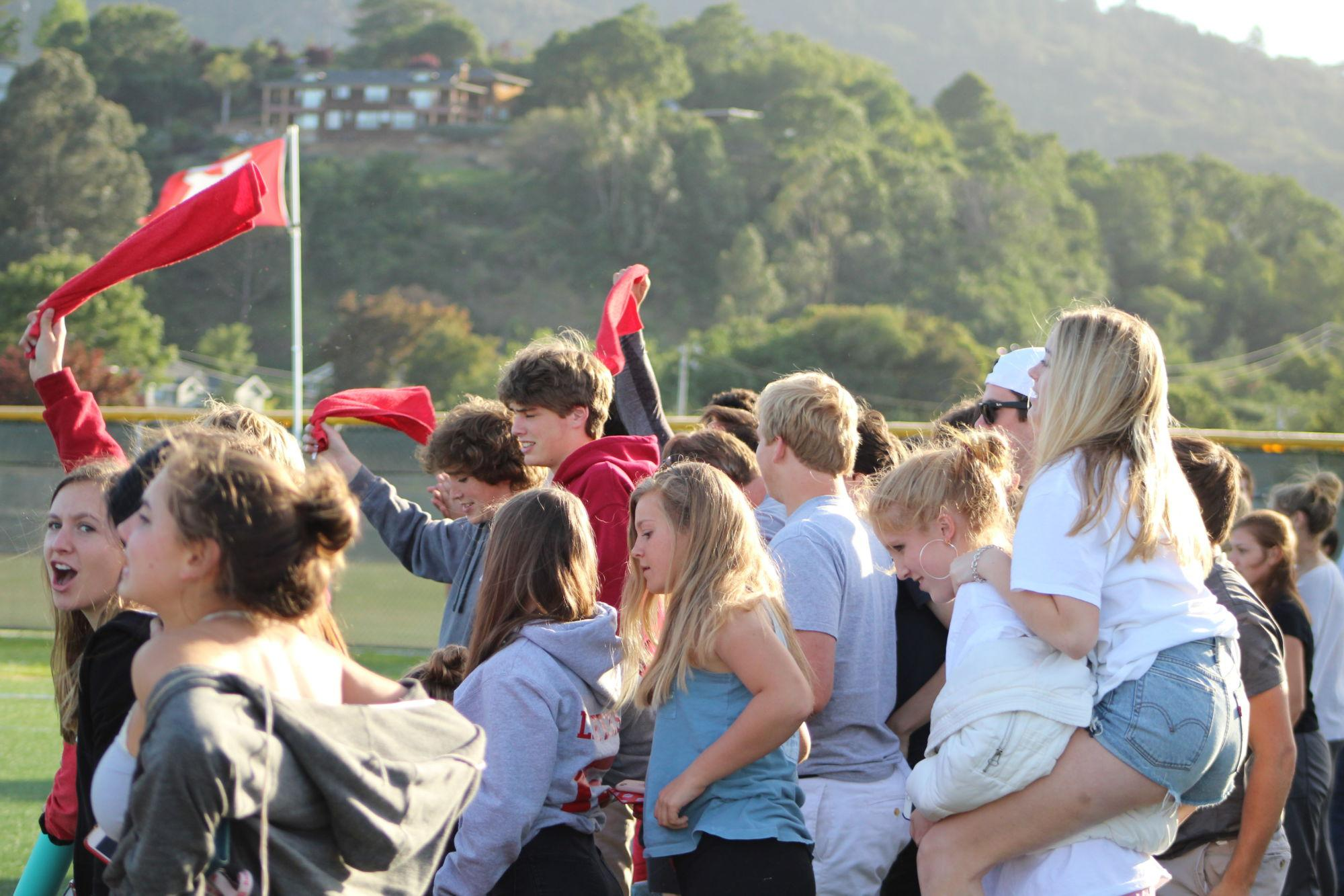 Fans+stand+up+and+become+excited+when+Redwood+scores.