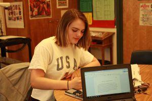 Senior Avrelle Harrington works on her final AP research presentation.