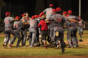 The Giants storm the field after winning the MCAL championship