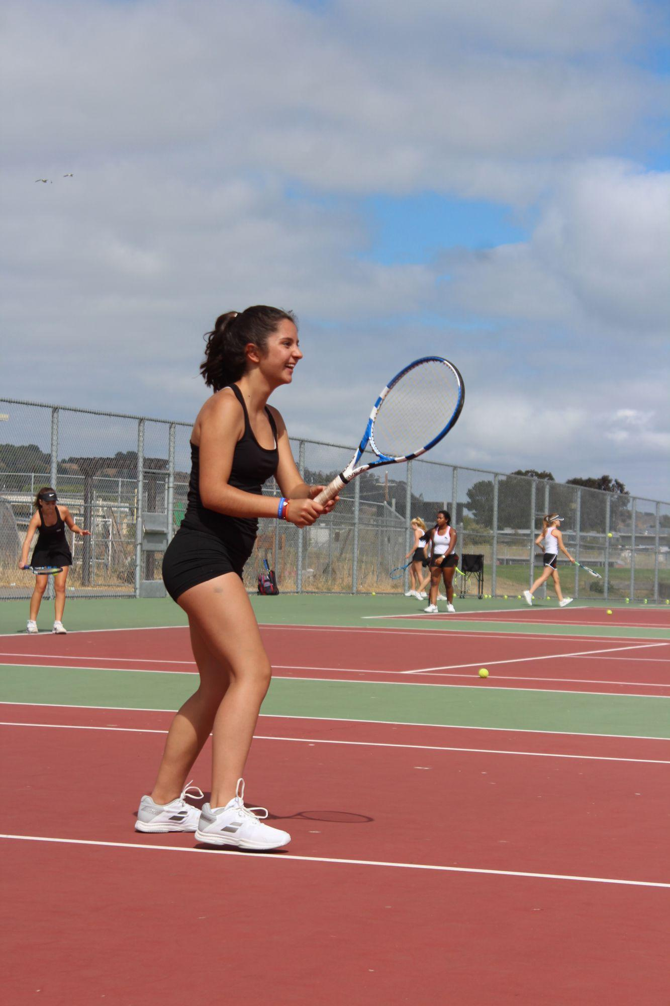 Pablos anticipates a serve from one of her teammates.