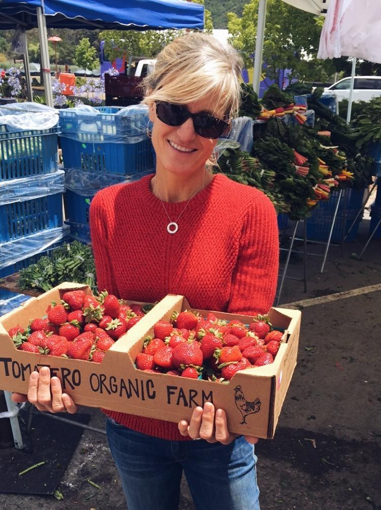 Leanne with some strawberries at the farmers market