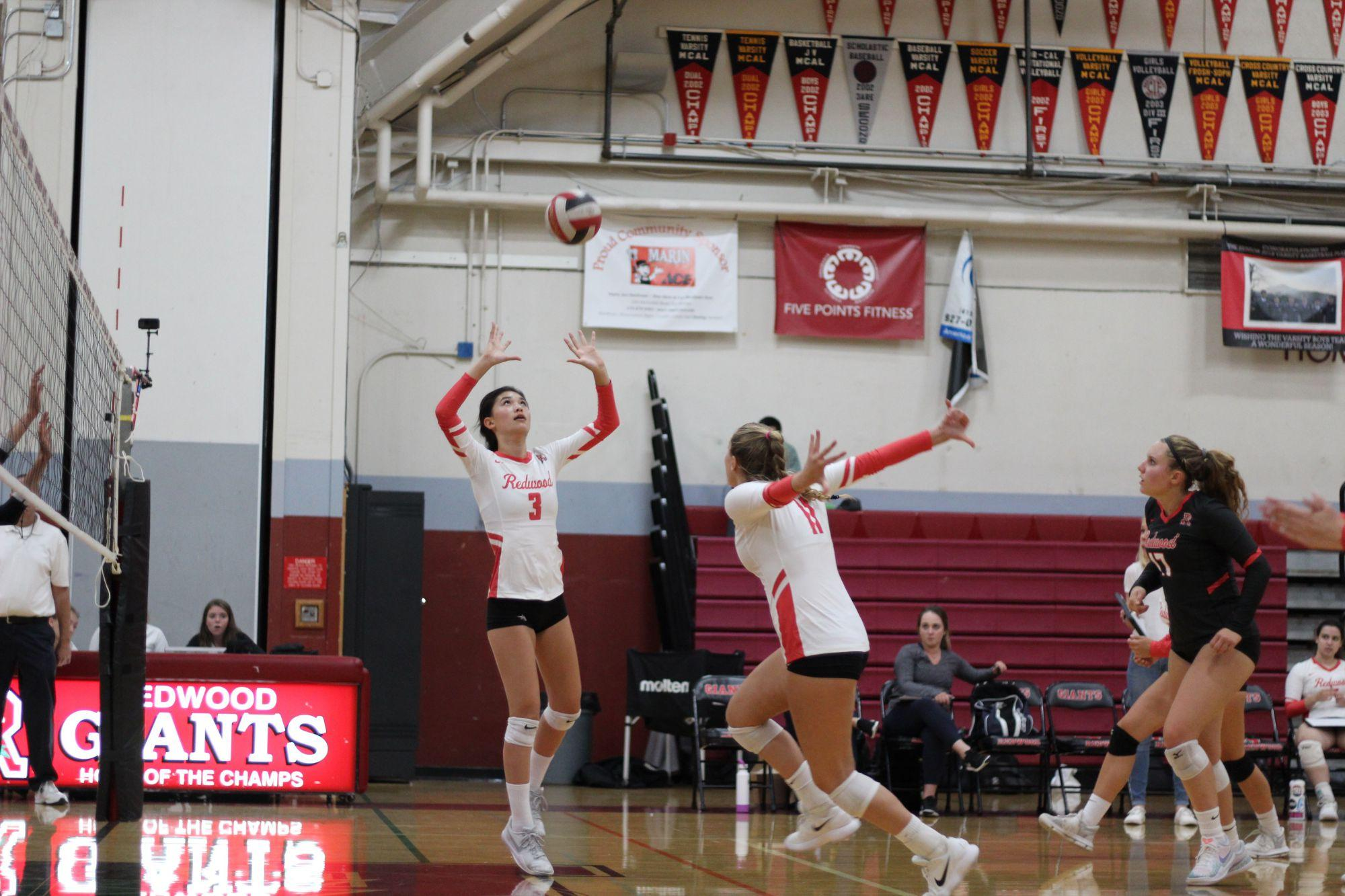 Girls' varsity volleyball buries Piedmont with three-set victory