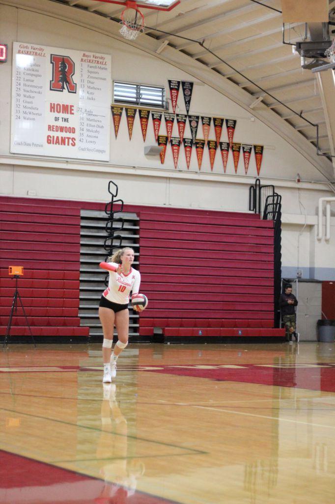 Senior+Ella+Spaethling+serves+the+ball.+