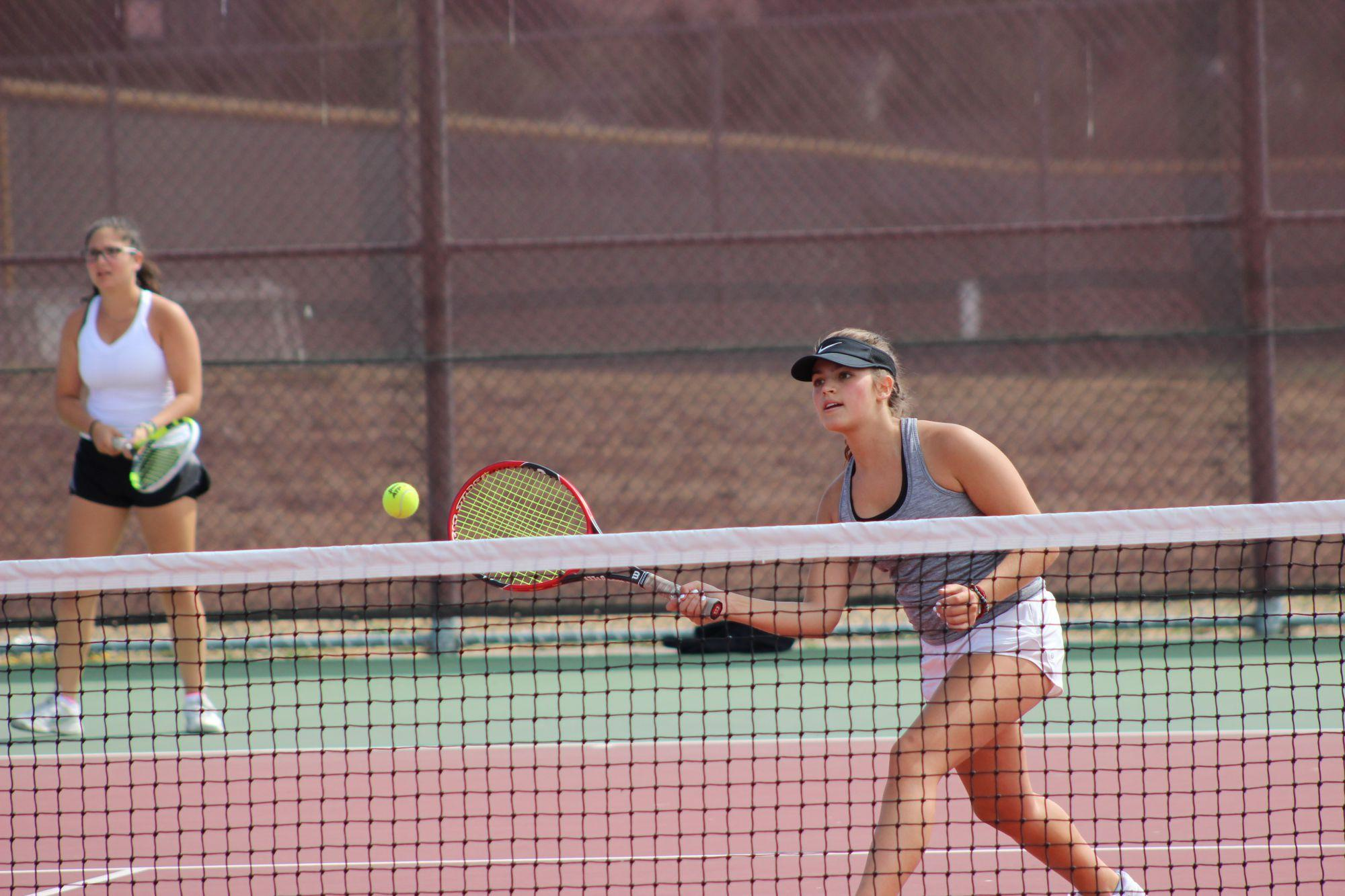 Junior Lindsay Dubin practices her forehand volley during warmups