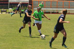 Avoiding the defender, Pero pushes the ball upfield