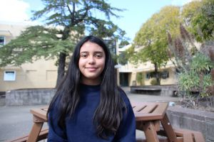 Sitting in the quad, Saidy Reyes takes in another sunny day at Redwood.