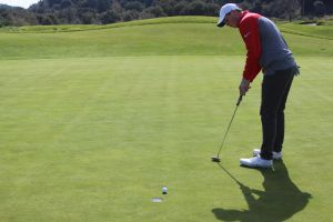 Solter drains putt to save par on the 9th hole at the Meadow Club