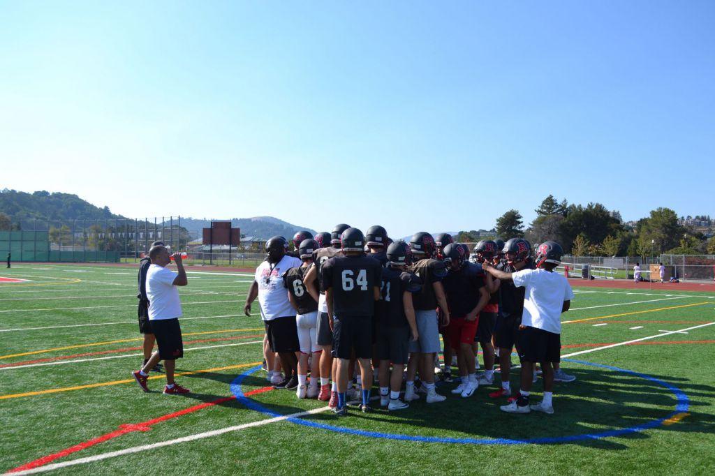 Huddling around senior captain Alex Aguero, the team prepares to break