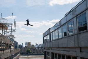 Jumping across two buildings, Ethan Hunt (Tom Cruise) executes a stunt which broke the actor's ankle.