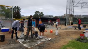 Working hard, Jake Nordstrom and his friends help clean the freshman baseball field.