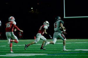 Alex Aguero runs through SR defense for a touchdown