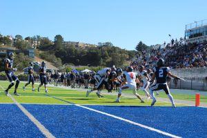 Junior Henry Minturn stops MC running back from touchdown.
