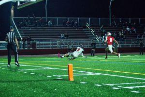 Receiver Alex Hagen dives for touchdown pass from quarterback Matthew Smalbach